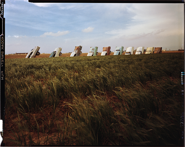 Cadillac Ranch in its original condition, taken in 1976. Once the graffiti mobs got started there was no stopping them.
